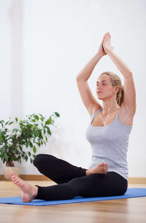 Woman doing yoga relaxing after long day photo