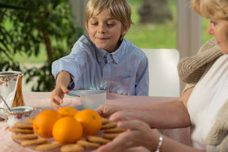 homey: Cute boy spending time at grandmothers home Stock Photo