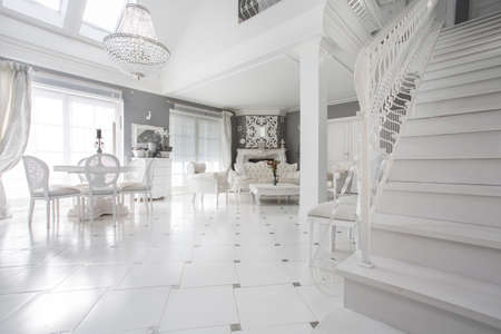 chandeliers: Exclusive white living room with marble floor Stock Photo