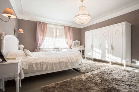 enormous: Enormous luxury old fashioned bedroom with crystal chandelier
