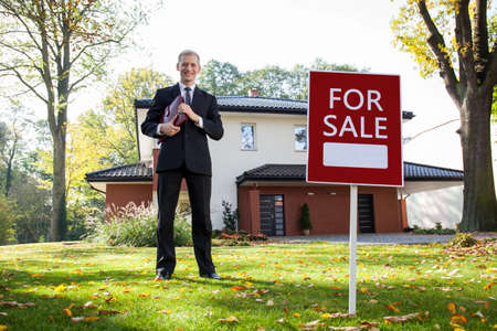 Young and handsome real estate agent in work