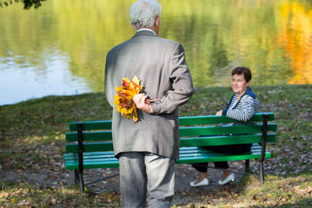 beloved: Aged woman with his beloved wife in park Stock Photo