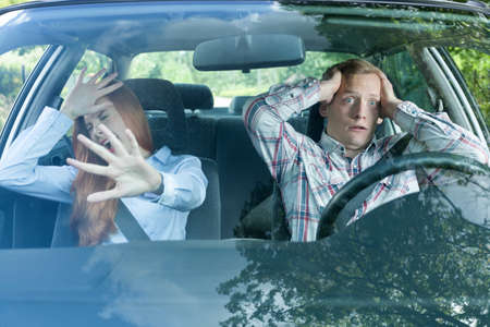 drive crash: Couple in a car about to have a crash Stock Photo
