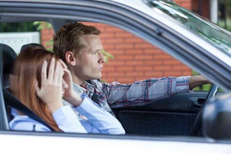 abuse young woman: Young people having a fight while driving a car Stock Photo