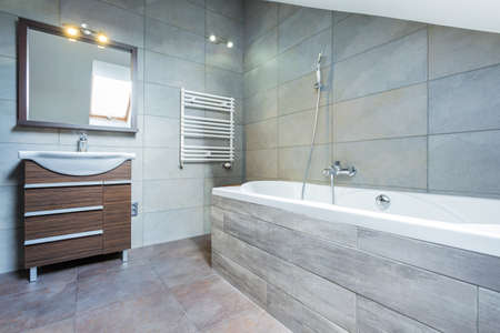 bathroom design: Bathroom interior with bath and wooden shelf Stock Photo