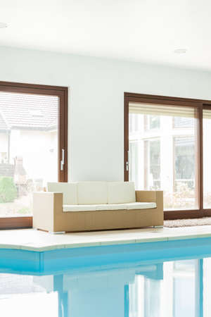 Sofa at the swimming pool in luxury residence photo
