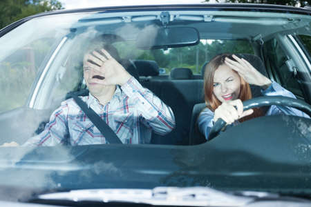 traffic accidents: Young couple in car blinded by high beam lights