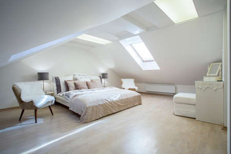 double bed: Double bed with a lot of cushions in luxury apartment