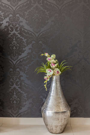 Vertical view of flower in old-fashioned vase