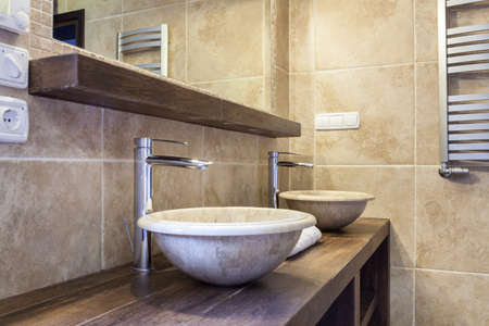 bathroom tiles: Interior of expensive toilet with marble washbasin