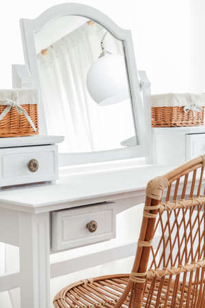 anteroom: Close-up of beauty dressing table with wicker baskets