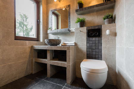 Modern beauty toilet interior with marble tiles Imagens