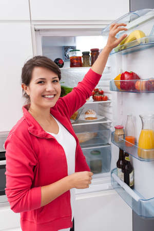 vertical fridge: Young lovely woman and her fit meal Stock Photo