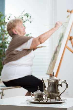 free time: Older active woman creating an image in her free time