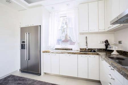 granite: White , modern kitchen with granite tops Stock Photo
