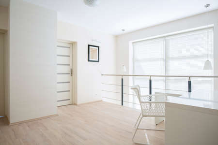 mezzanine: Bright, white corridor on mezzanine floor