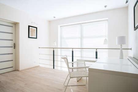 Bright home office placed on mezzanine floor Stok Fotoğraf