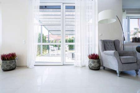 Balcony window in the living room with garden view Standard-Bild