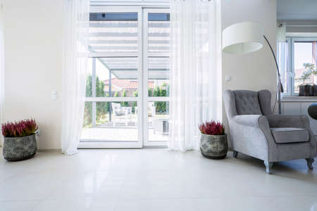 Balcony window in the living room with garden view Stockfoto