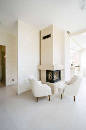 Modern fireplace in white, spacious living room photo