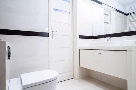 furnishings: Small black and white bathroom with modern furnishings