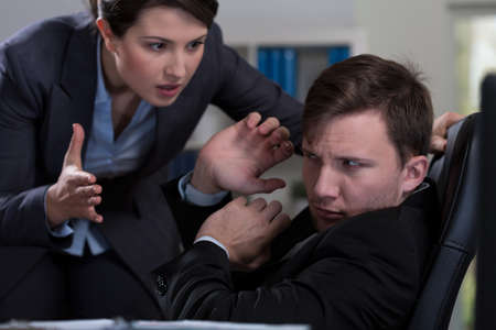 harassment: Young handsome man and workplace bullying Stock Photo