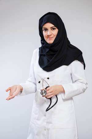 Female muslim doctor isolated on white background photo