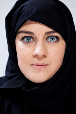 Portrait of muslim woman in black headscarf photo