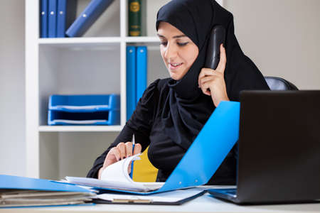 religious: View of female muslim in the office Stock Photo