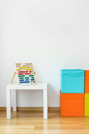 Photo of colorful childrens toys in room
