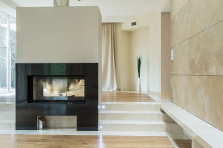 Close-up of fireplace in bright luxury mansion