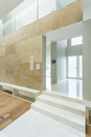 Vertical view of white and beige spacious interior photo
