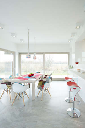 Contemporary dining room interior with designer chairs