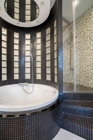 expensive granite: Photo of the big round bath in cristal bathroom