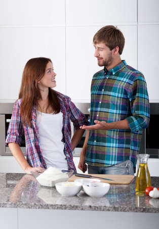 make a paste: Loved couple in the kitchen preparing supper