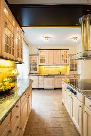 Spacious old fashioned kitchen in a big luxury house photo