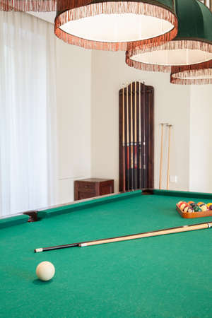 billiards room: Close-up of billiard cue on billiard table