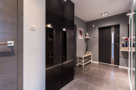 anteroom: Anteroom with gray painted wall in contemporary residence Stock Photo