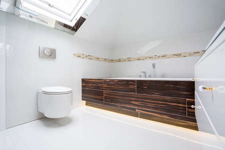 Modern estate white bathroom with wooden units