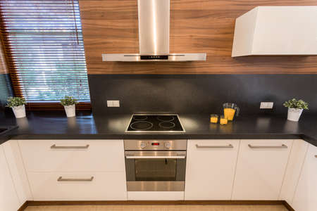 units: New silver oven builded in white units in new modern kitchen Stock Photo