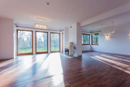 Bright spacious front room with stove Archivio Fotografico