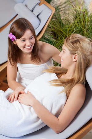 sunbed: Two cute girls spending time together at spa Stock Photo