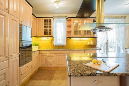 Horizontal view of beige furniture in  luxury kitchen