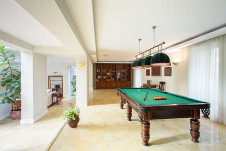 parlour games: Billiard table in living room in luxury apartment