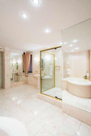 handbasin: Bright illuminated washroom interior in luxury house