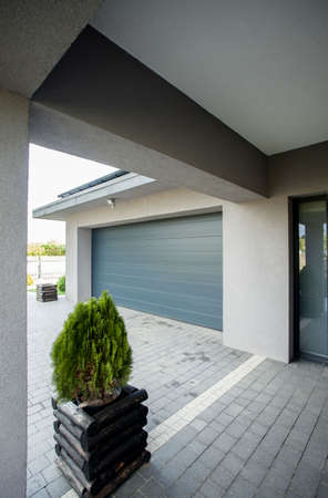 car door: Picture of the entrace to the big new garage in the house