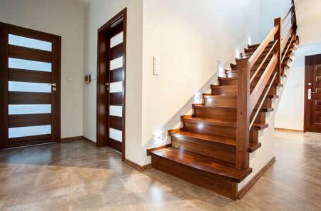 Luxury hallway with woden stairs to bedroom on teh floor photo