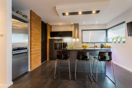 contemporary: View of brick wall in contemporary kitchen Stock Photo