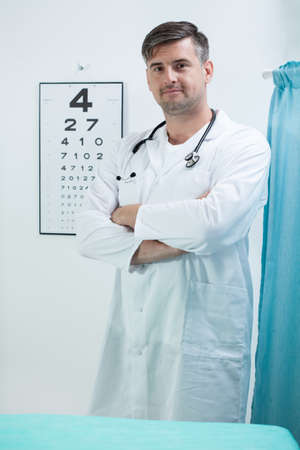 general pediatrician: Vertical view of doctor in his office Stock Photo