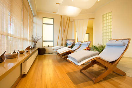spa: Close-up of loungers in cozy spa room Stock Photo